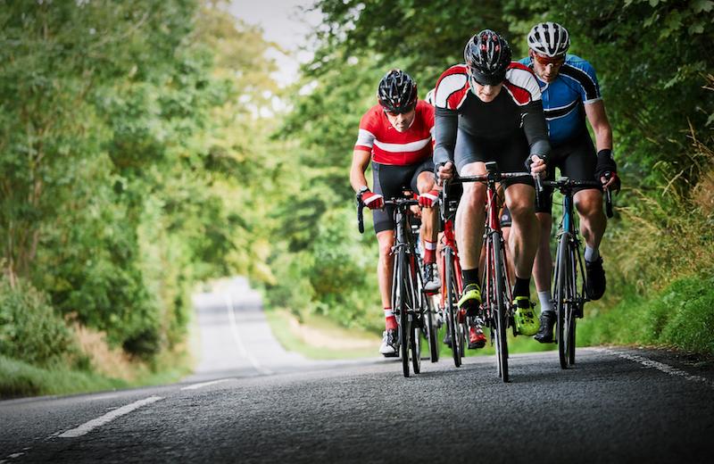 Small group biking on pretty road